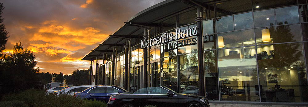 Mercedes-Benz Canberra exterior at sunset with vehicles on display
